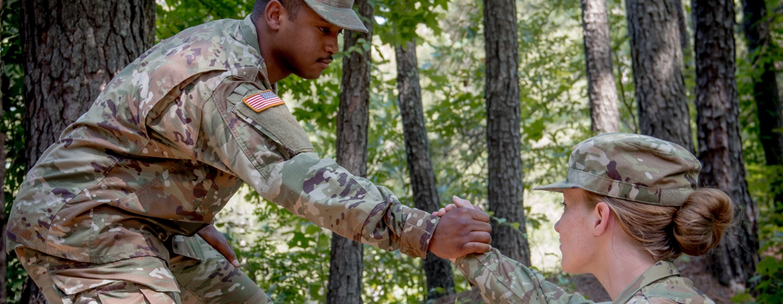 soldier helping soldier