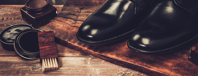 Black dress shoes and shoe shine supplies.